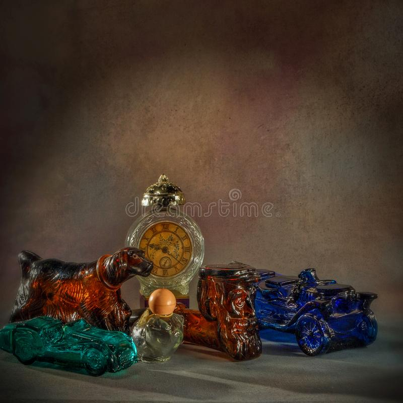 Vintage Perfume bottles in different shapesClasic Glass works-Figural bottles-studio shot kalyan near mumbai maharashtra INDIA. 31 Oct 2005 Vintage Perfume royalty free stock photo