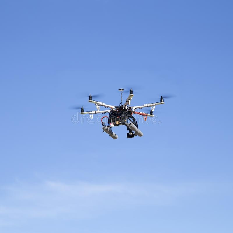 Octacopter drone flying royalty free stock image