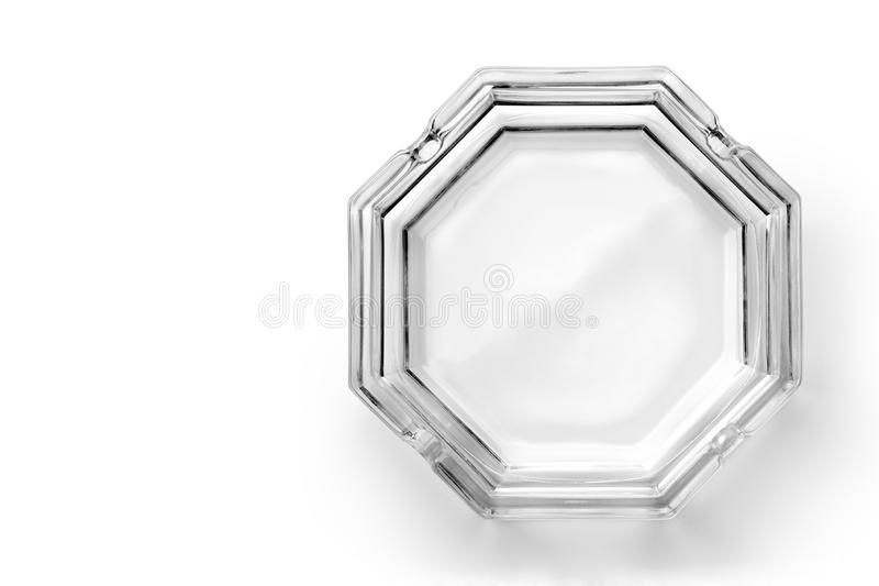 Octagonal glass ashtray. Isolated on white background. Top view royalty free stock photo
