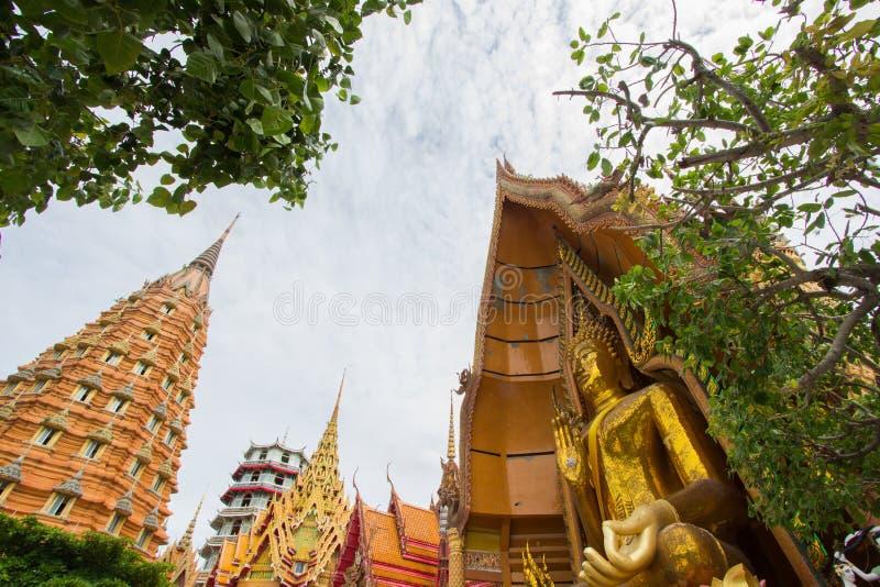 Octagonal pagoda,Chinese Pagoda,Vihara and large golden Buddha statue at Wat Tham SuaTiger Cave Temple,Tha Muang District,Kancha stock photos