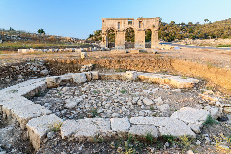 Octagonal pool in ancient Lycian city Patara. Turkey. Octagonal pool and Arch of Mettius Modestus in ancient Lycian city Patara. Antalya Province. Turkey stock images
