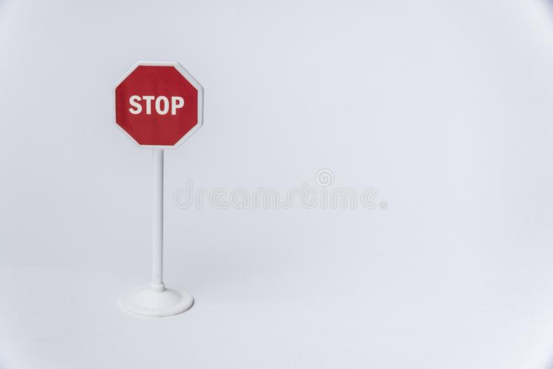 Octagonal red stop sign on white background. Copy space royalty free stock image