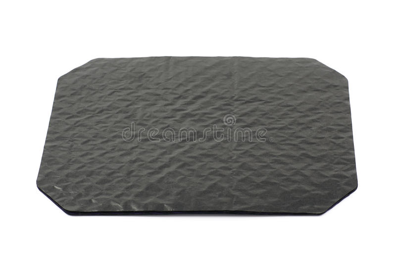 Octagonal sheet of black cardboard. Octagonal sheet of black waxed cardboard paper isolated over the white background royalty free stock photography