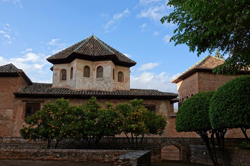 Nasrid palace with octagonal roof at the Alhambra in Granada, Andalusia. Octagonal tiled roof and intricate carved windows at Nasrid palace stock image