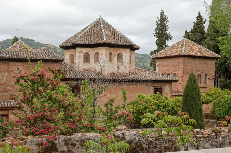 Nasrid palace with octagonal roof at the Alhambra in Granada, Andalusia. Octagonal tiled roof and intricate carved windows, of the room of the Abencerrajes royalty free stock photos