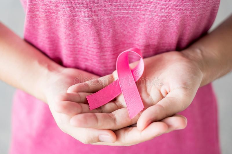 October Breast Cancer Awareness month, Woman in pink T- shirt with hand holding Pink Ribbon for supporting people living and. Illness. Healthcare, International royalty free stock image