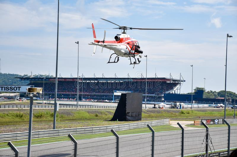 4 October 2019 Buriram Thailand The pilot is preparing a helicopter for live broadcasting of the Grand Prix motorcycle racing stock photography