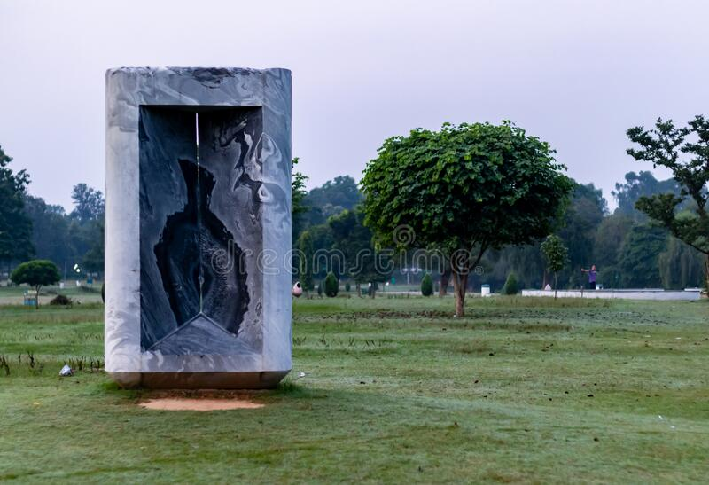 October 9, 2019, Chandigarh, India. One person exercising in the garden on a winter morning with beautiful marble structure in the. Garden stock photography
