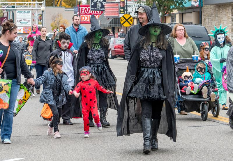 kids in Halloween costumes are out en-mass during a Trick or treat event royalty free stock image