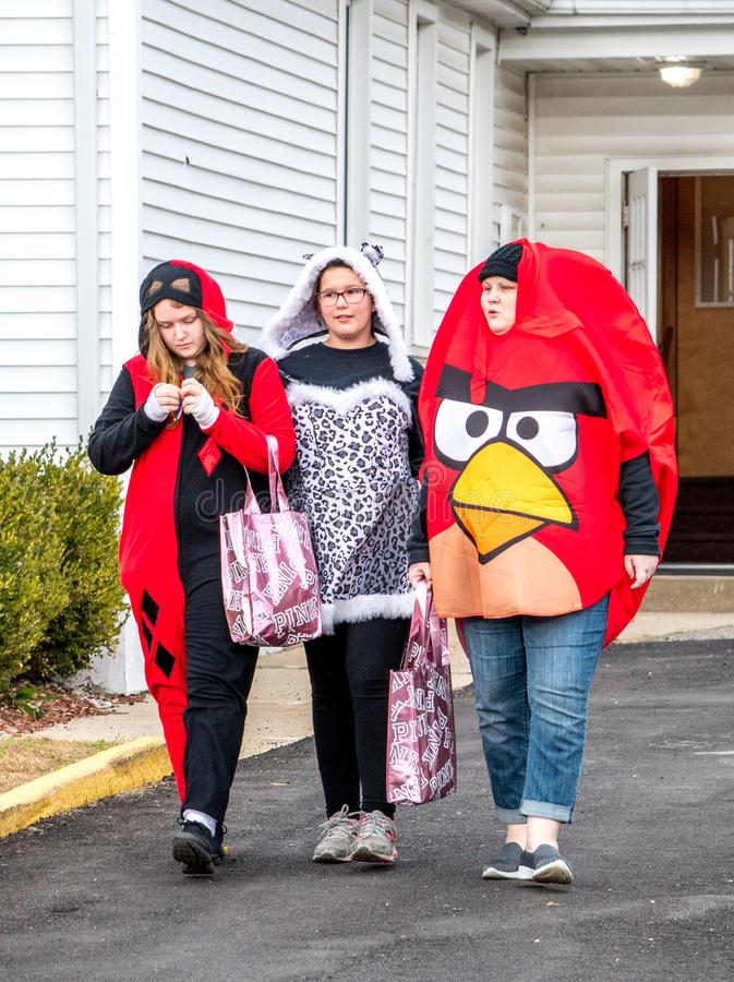young tweens, kids not quite teenage years, are out trick or treating during a Halloween event royalty free stock photos