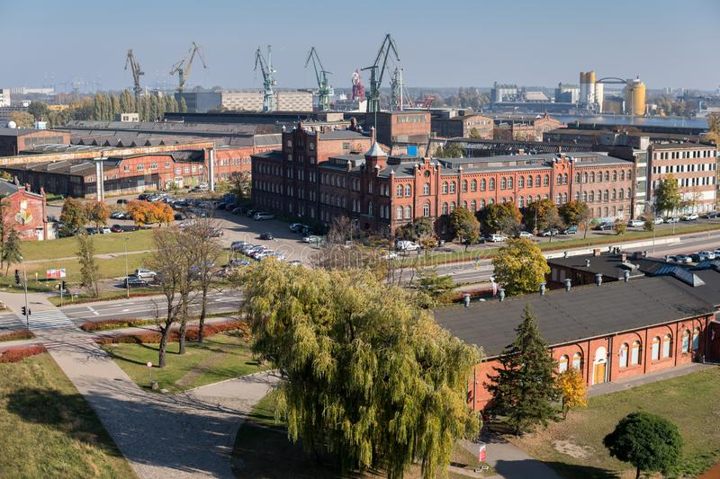 Cranes in gdansk shipyard. October, 2018, Gdansk, Poland: city landscape with former building of gdansk shipyard, Historical place of Polish workers strike in royalty free stock photos