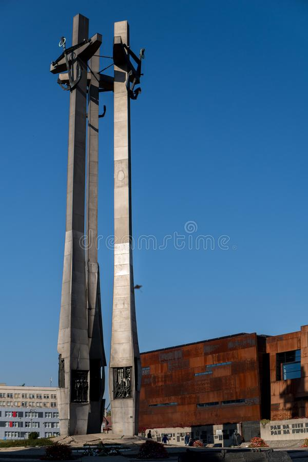 Monument to the fallen shipyard workers. October 2018, Gdansk, Poland: Monument to the fallen shipyard workers in front of Solidarity museum royalty free stock photo
