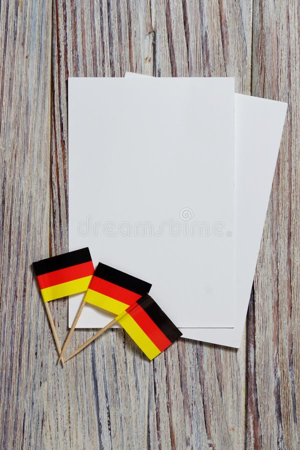 October 3.happy Day of German unity. the concept of patriotism , freedom and independence. Mini flags with a white card on wooden. Day of German Unity written in royalty free stock photo
