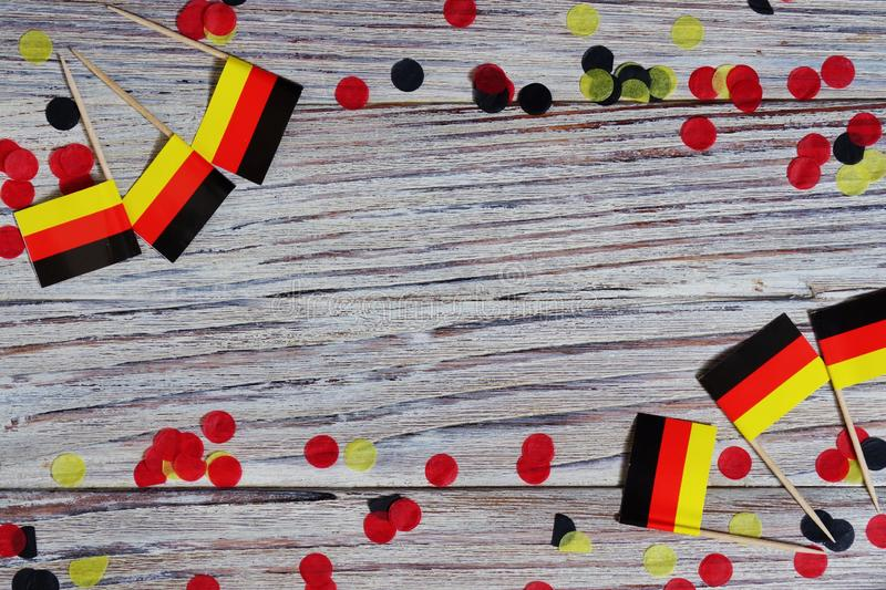 October 3, happy German independence Day. the concept of patriotism , freedom and independence. Mini paper flags with yellow and. Day of German Unity written in royalty free stock photos