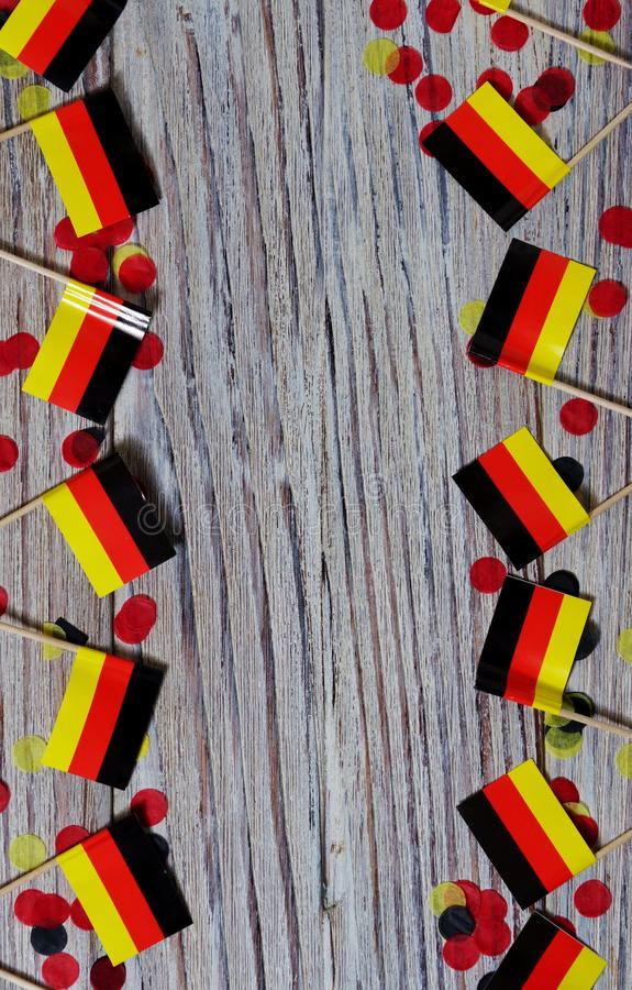 October 3, happy German independence Day. the concept of patriotism , freedom and independence. Mini paper flags with confetti on. Day of German Unity written in stock images