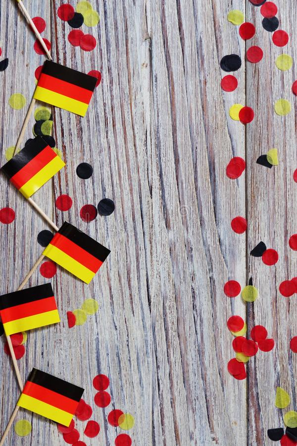 October 3, happy German independence Day. the concept of patriotism , freedom and independence. Mini paper flags with confetti on royalty free stock photography