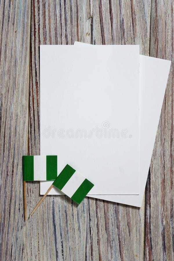 October 1. happy independence Day of Nigeria. the concept of patriotism , freedom and independence. Mini flags with a white card royalty free stock images