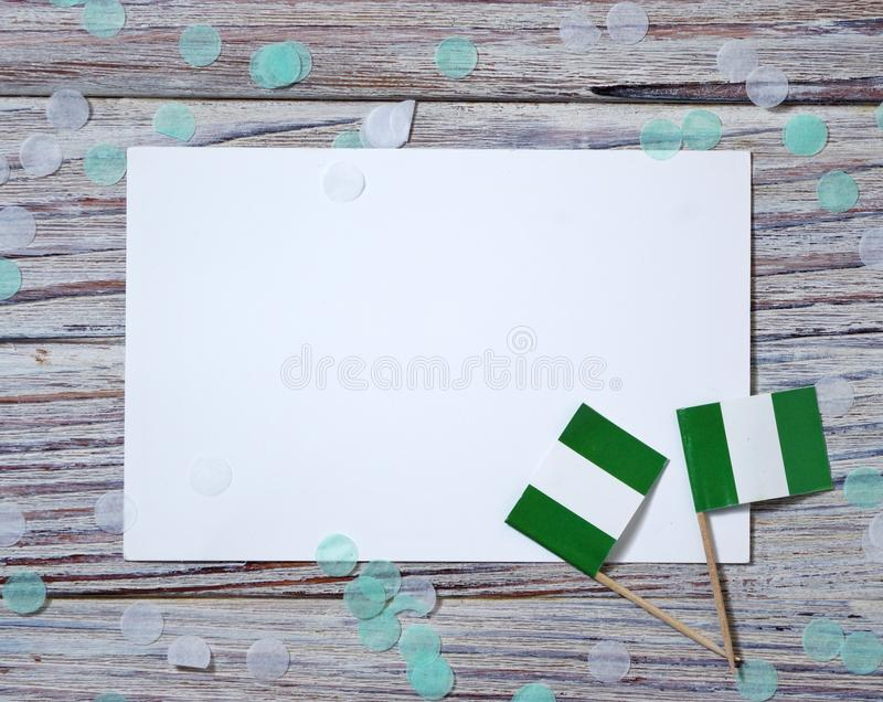 October 1. happy independence Day of Nigeria. the concept of patriotism , freedom and independence. Mini paper flags with yellow stock photos