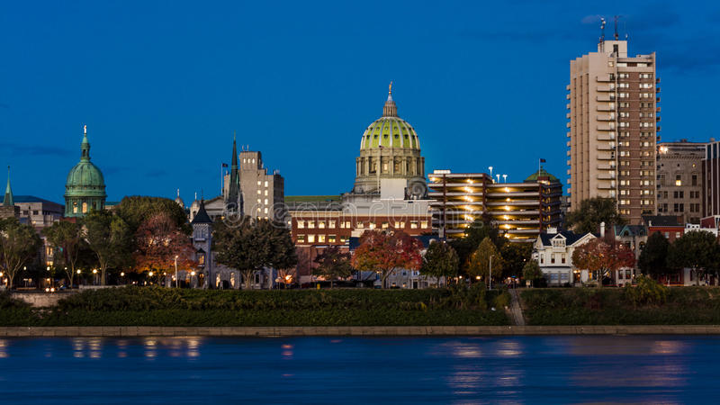 OCTOBER 25, 2016 - HARRISBURG, PENNSYLVANIA, City skyline and State Capitol shot at dusk from Susquehanna River, PA royalty free stock photography