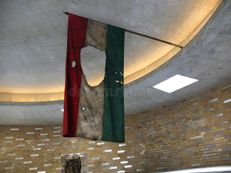 Hungarian flag, testimony of the Budapest uprising in 1956. On October 23, 1956, the inhabitants of Budapest demonstrate against the communist government of stock images