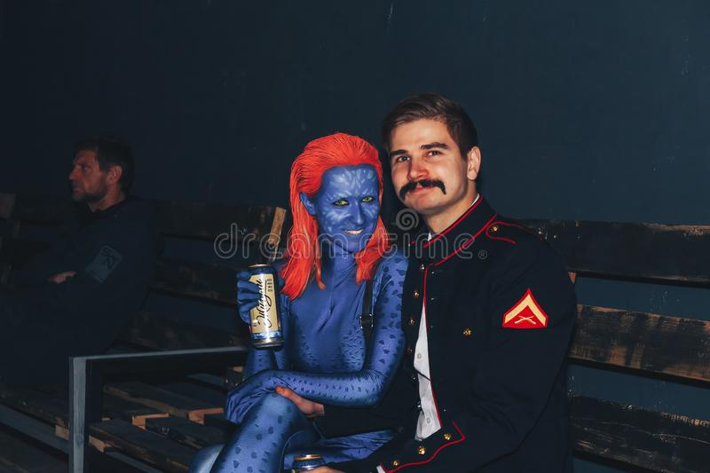 October 28-29, 2017 Minsk Belarus Art space Top Party dedicated to the holiday HELLOWEEN. Woman and man in make-up and costumes sit in a nightclub stock photos