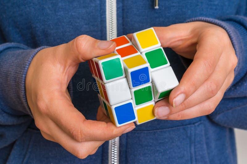 Rubik`s cube in female hands - game for solving problems. 5 OCTOBER 2017 PRAGUE, CZECH REPUBLIC: Rubik`s cube in female hands stock images