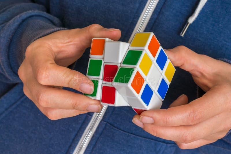 Rubik`s cube in female hands - game for solving problems. 5 OCTOBER 2017 PRAGUE, CZECH REPUBLIC: Rubik`s cube in female hands stock photography
