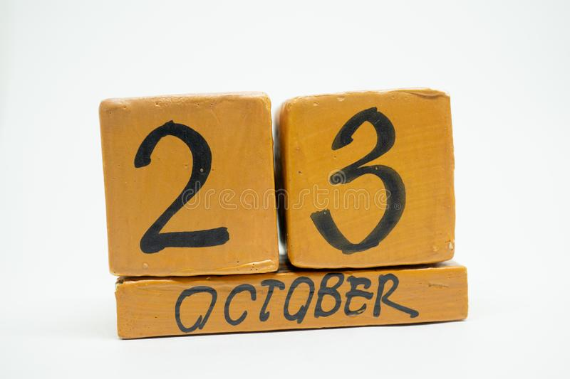 October 23rd. Day 23 of month, handmade wood calendar isolated on white background. autumn month, day of the year concept. October 23rd. Day 23 of month royalty free stock photo