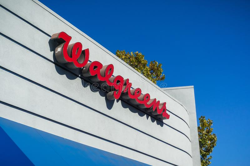 Walgreens logo. October 26, 2017 Sunnyvale/California - Walgreens logo above the pharmacy entrance royalty free stock photography
