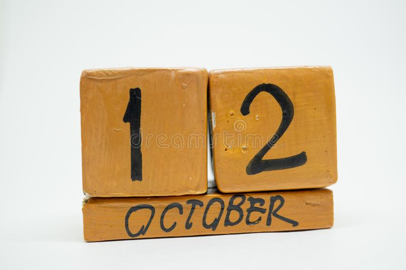 October 12th. Day 12 of month, handmade wood calendar isolated on white background. autumn month, day of the year concept. October 12th. Day 12 of month stock image