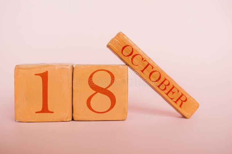 October 18th. Day 18 of month, handmade wood calendar  on modern color background. autumn month, day of the year concept. October 18th. Day 18 of month, handmade stock photos