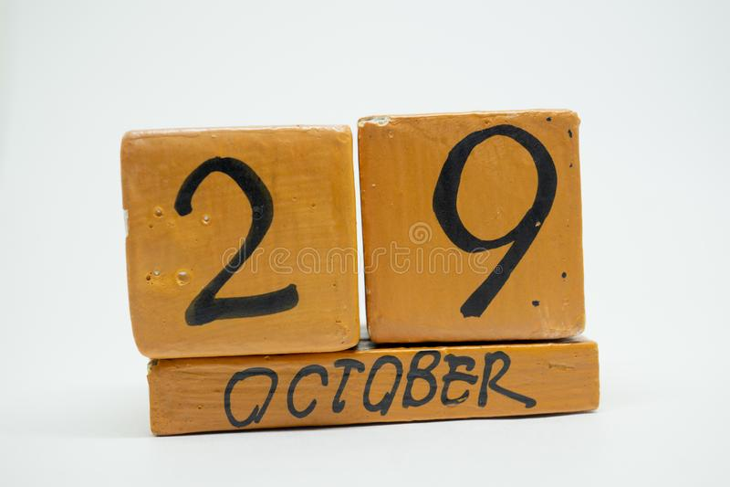 October 29th. Day 29 of month, handmade wood calendar isolated on white background. autumn month, day of the year concept. October 29th. Day 29 of month stock photography