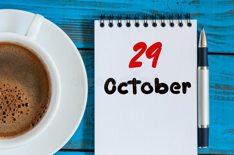 October 29th. Day 29 of month, hot drink cup with calendar on human-resources manager workplace background. Autumn time. Empty space for text stock images