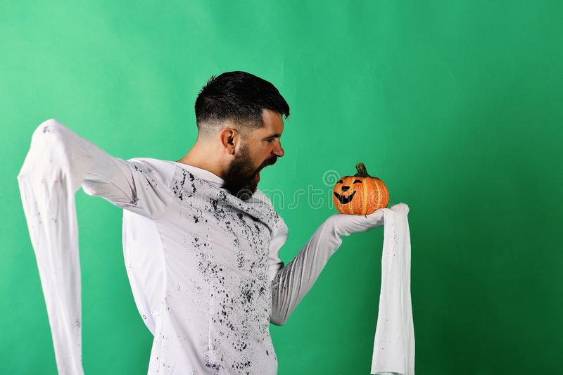 October time and spooky holiday concept. Man with mad face royalty free stock photography