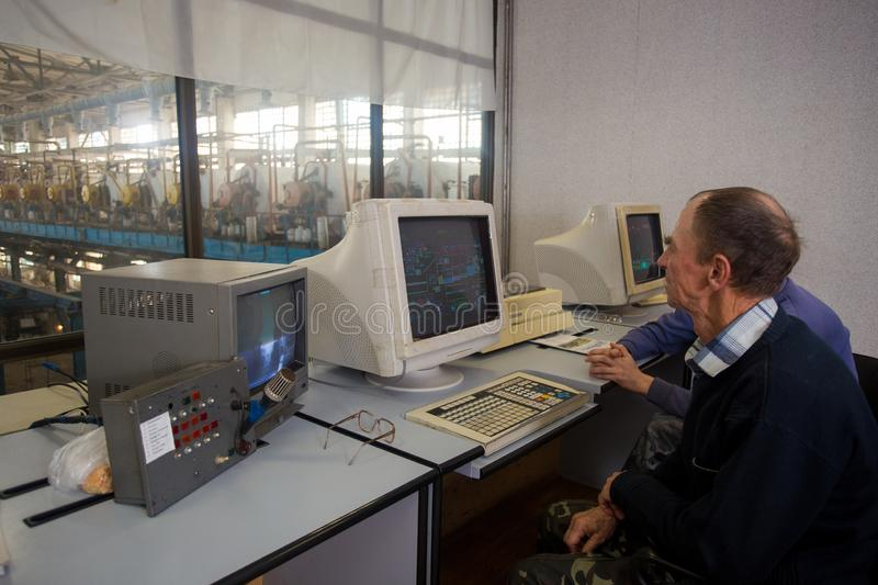 October 10, 2014. Ukraine.Kiev. Subject industry and people at work. Caucasians in the factory control room are closely monitoring. Information on the monitors royalty free stock photo