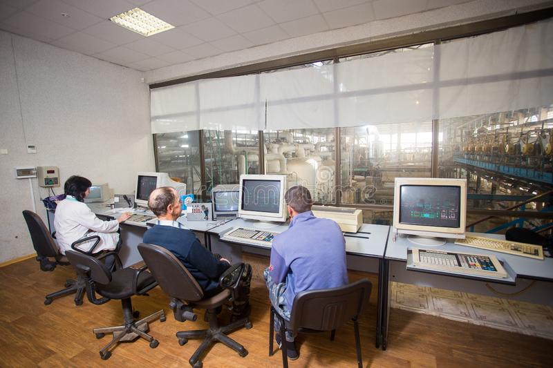 October 10, 2014. Ukraine.Kiev. Subject industry and people at work. Caucasians in the factory control room are closely monitoring. Information on the monitors stock images