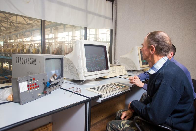 October 10, 2014. Ukraine.Kiev. Subject industry and people at work. Caucasians in the factory control room are closely monitoring. Information on the monitors stock photos
