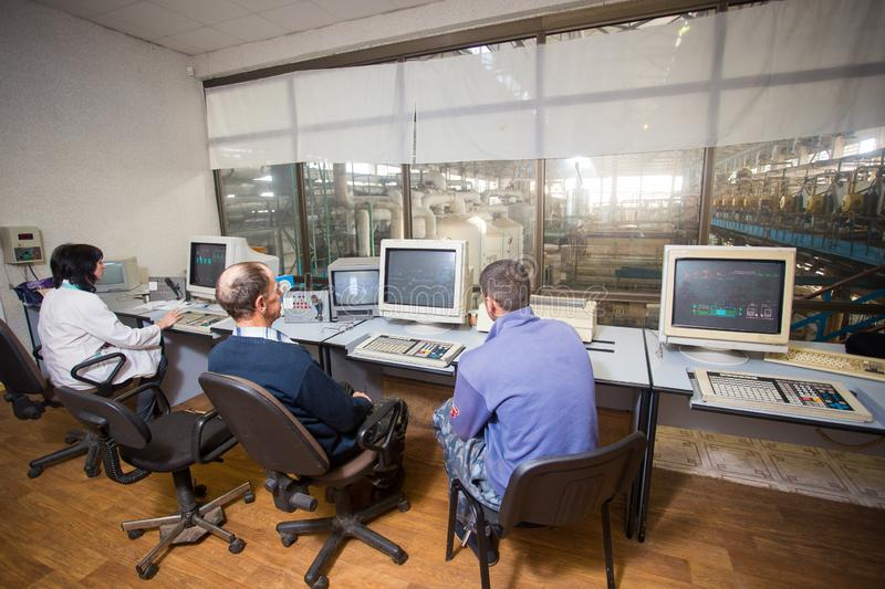 October 10, 2014. Ukraine.Kiev. Subject industry and people at work. Caucasians in the factory control room are closely monitoring. Information on the monitors royalty free stock images