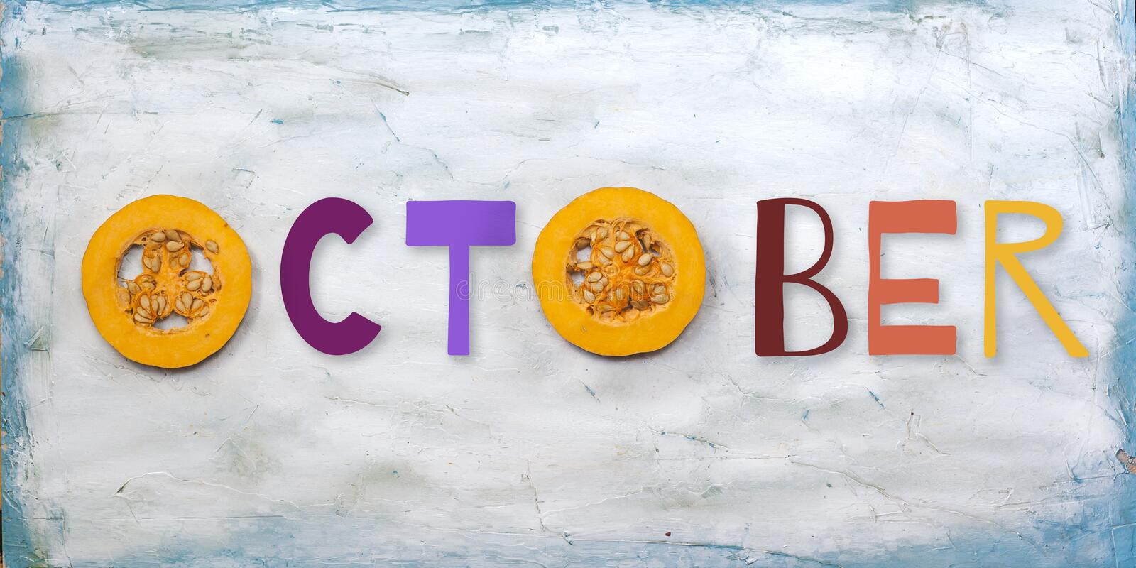 October. Word made with round sliced pumpkin pieces stock image