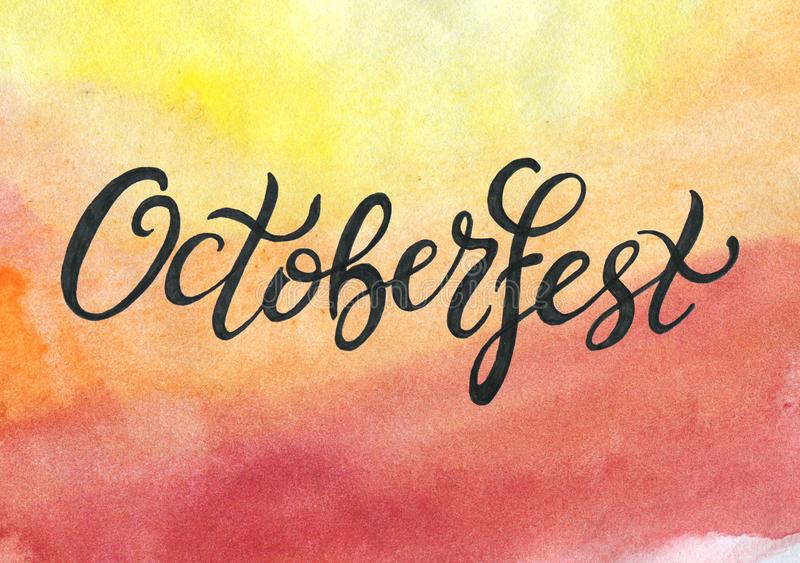 Octoberfest handwritten black ink lettering on yellow orange red watercolor background. Oktoberfest typography design for greeting cards and poster stock illustration