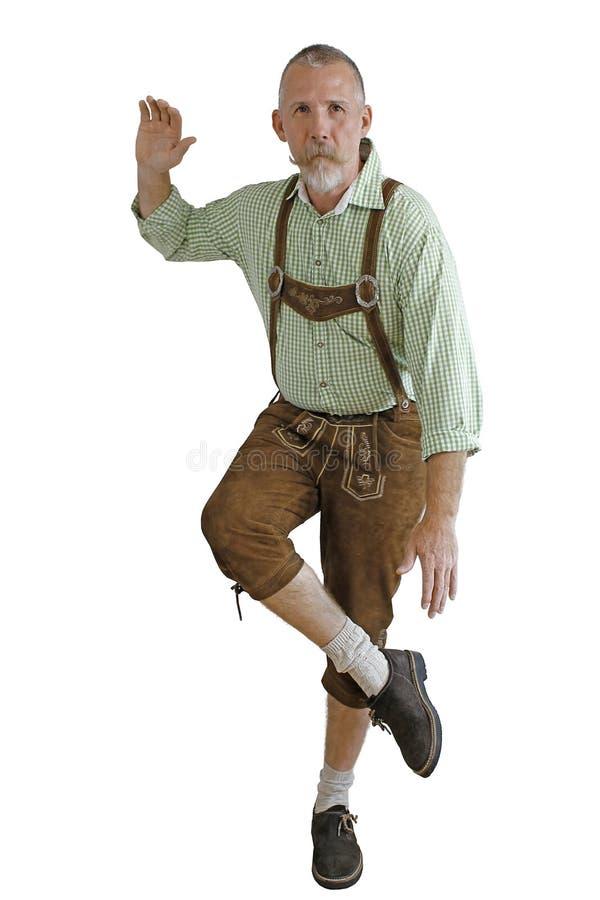 Octoberfest man dancing. Bavarian man doing bavarian folk dance on the octoberfest in munich in germany royalty free stock photography