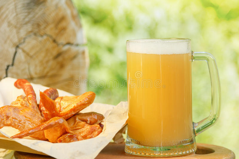 Octoberfest mug beer with food weekend. Octoberfest mug beer with traditional food on nature background stock image