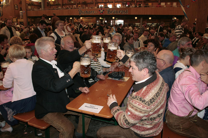 Octoberfest in Munich, Germany. Picture of the people drinking bear during Oktoberfest / Wiesn in Munich, Germany royalty free stock image