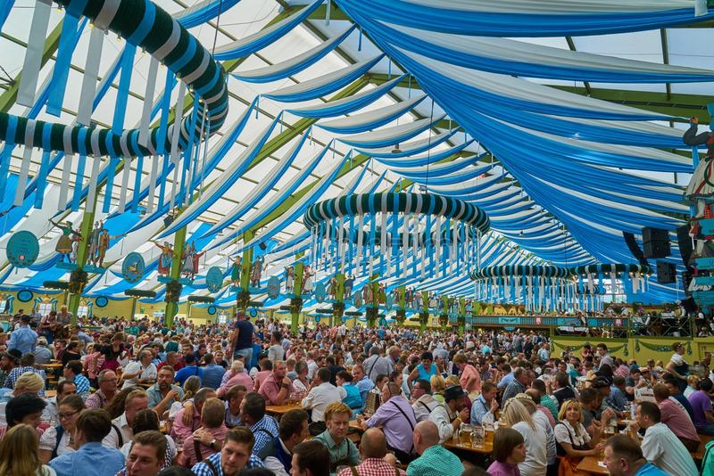 Octoberfest in munich. Scene of Octoberfest tent where local people drink beer and celebrate the festival in Munich, Bavaria, Germany royalty free stock image