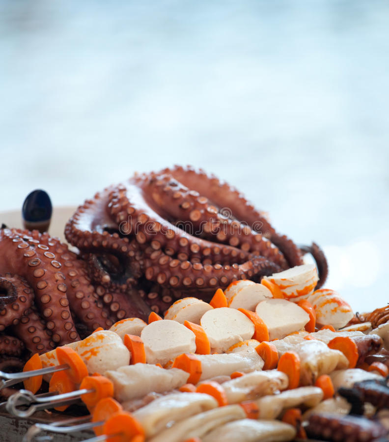 Octopus on beach in greece. Octopus and sea fish on beach in greece stock photo