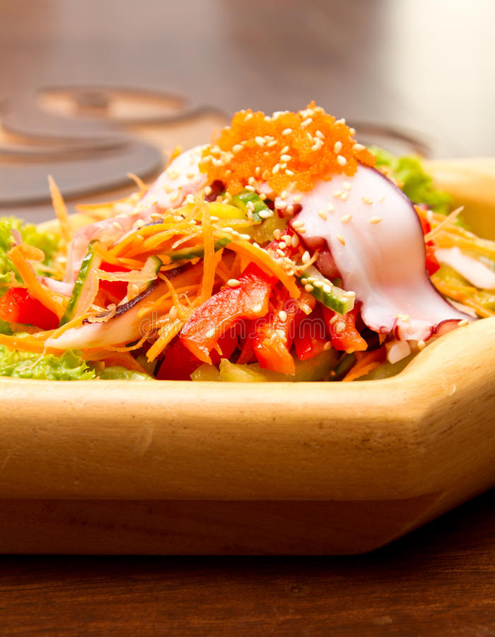 Octopus salad. With red caviar and vegetables stock image