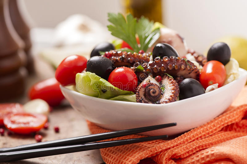Octopus Salad. With olives and tomatoes royalty free stock photography