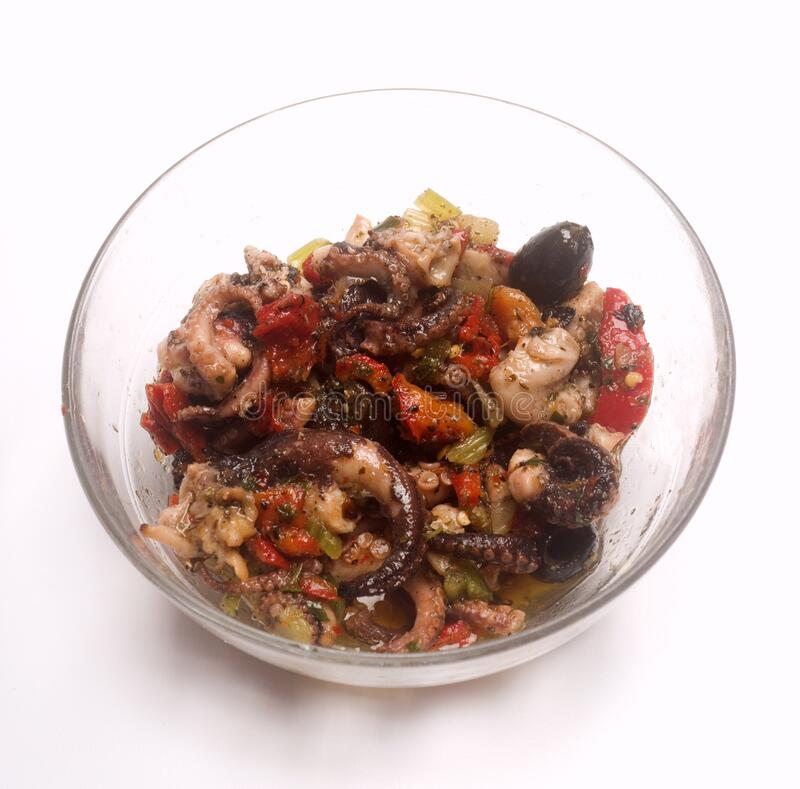Octopus salad with tomato celery black olives  royalty free stock photos
