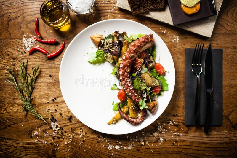 Octopus salad served on a plate in restaurant stock photography