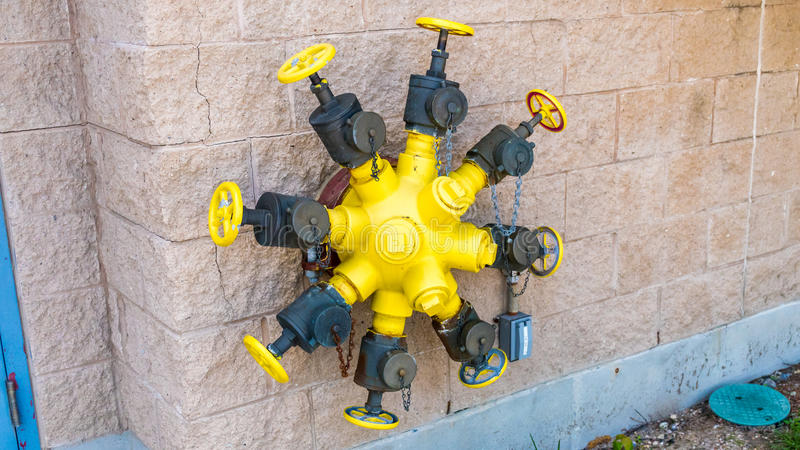 Octuplets Wall Mounted Fire Hydrant Valves. Hose connection stock photo